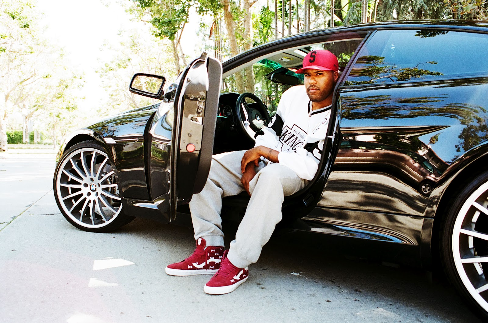photo of Dom Kennedy  - car
